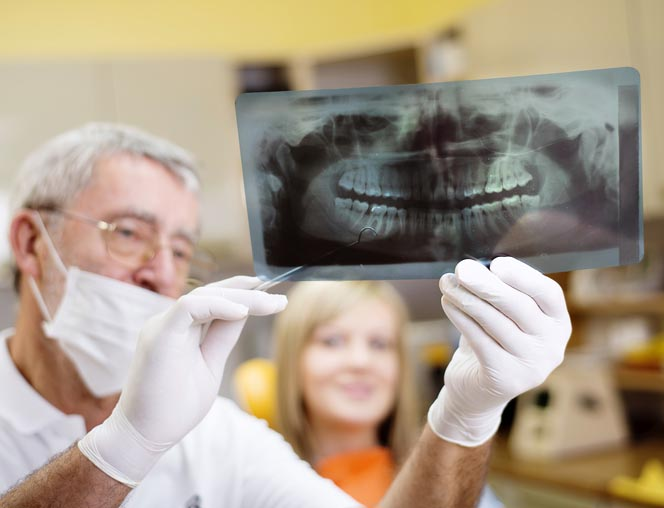 Dentist holding an X-ray