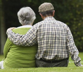 Older couple sitting in park