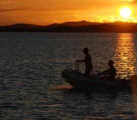 Couple Sailing on a Dinghy