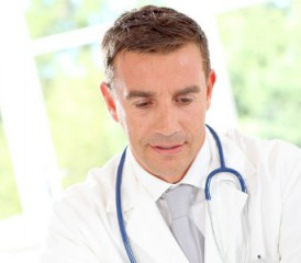 Male doctor with a stethoscope and white coat