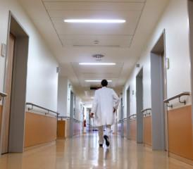Doctor walking down a hallway