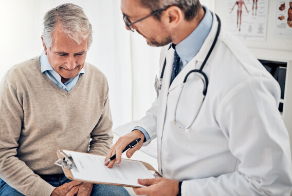 Doctor reviewing information with older patient