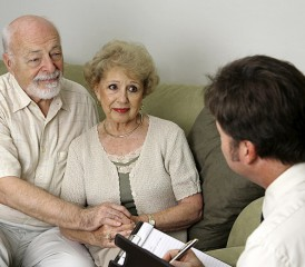 Elderly Couple Receiving News from a Doctor