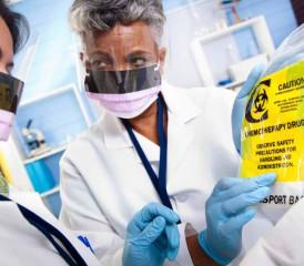 Doctors analyze a chemotherapy bag