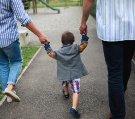 Family walking with a child
