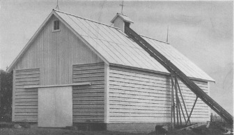 Vintage farmers corn crib made with asbestos materials