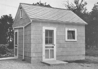 Vintage photo of a farmers' milk house built with asbestos