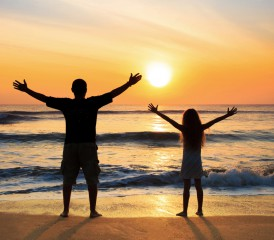 Father and daughter on a beach.