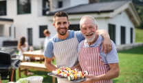 Father and son grilling with aprons
