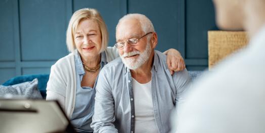 Elderly couple talking to financial advisor