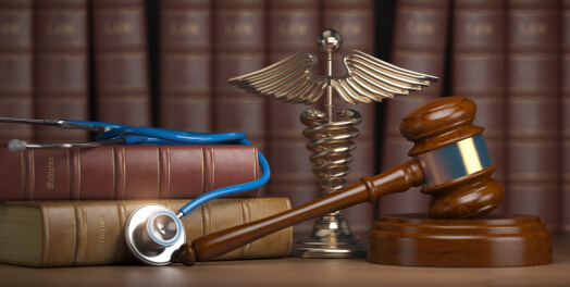 Books, justice symbol and gavel