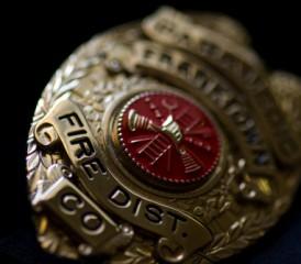 Firefighter badge on a black background