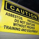 Black and yellow asbestos warning sign