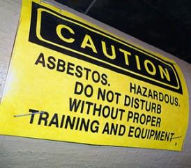 Black and yellow asbestos warning sign