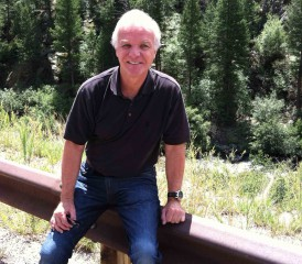 Mesothelioma Victim Gary M. in front of a forest