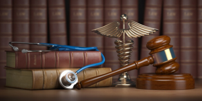 Gavel with stethoscope on legal books