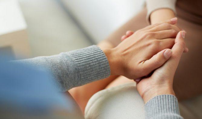 Gentle hands holding