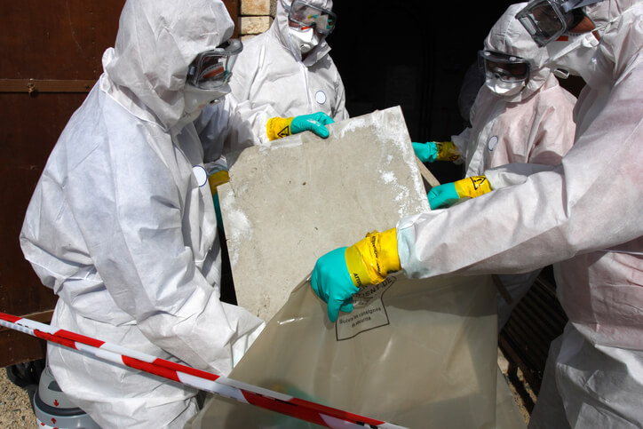 Abatement workers handling asbestos-contaminated products
