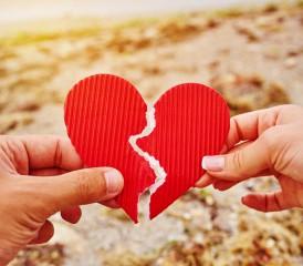 Hands holding a broken heart