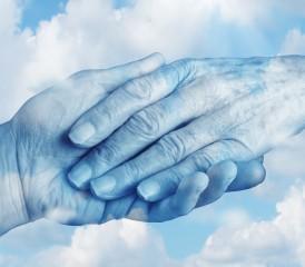 Hands holding in sky
