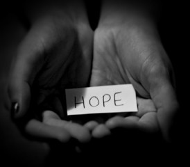 Hands holding a message of hope