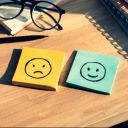 Post-its with happy and sad faces