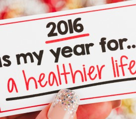 Person holding healthy New Year's Resolution card