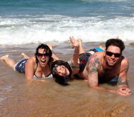 Mesothelioma Survivor Heather H. on beach with husband, Curt, and daughter, Stori