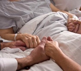 Holding Hands of a Loved One in a Hospital Bed