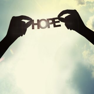 Holding paper cut of hope