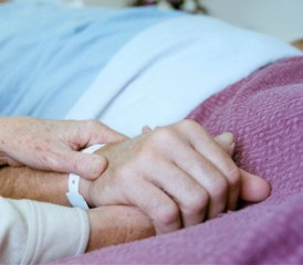 Person Holding Hospital Patient's Hand