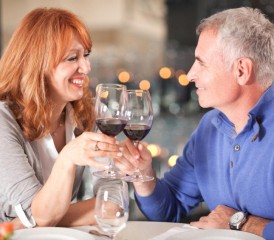 Older couple enjoying wine at dinner