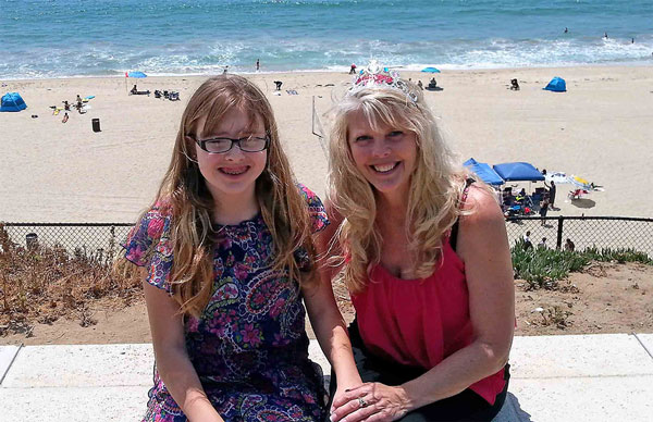 Karen Frantz with her daughter at the beach