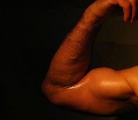 Man flexing bicep