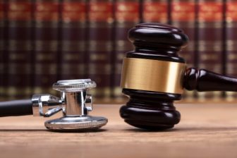Stethoscope and gavel with law books