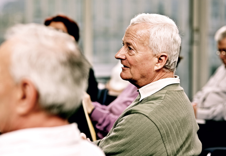 Elderly man participating in a support group
