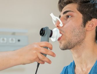 Doctor checking patient's lung capacity
