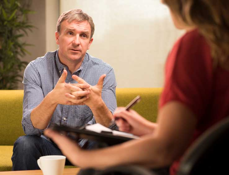 Man in a counseling session