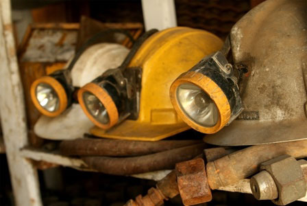 Dirty miners hard hats with light