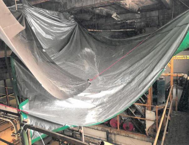 Tarp to catch asbestos debris at 207th St. Train Yard
