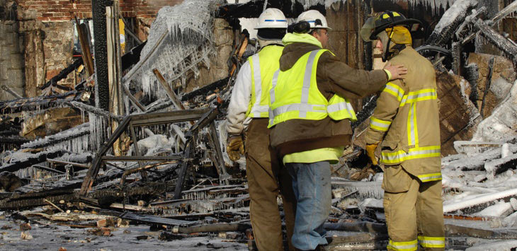 First responders evaluating damage following a natural disaster.