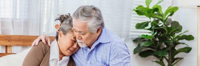 Older man comforting his wife
