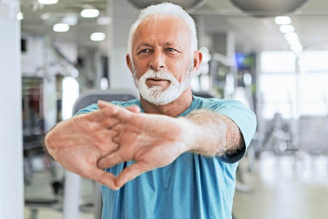 Older man stretching before exercise
