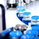 Blue vials on conveyor belt