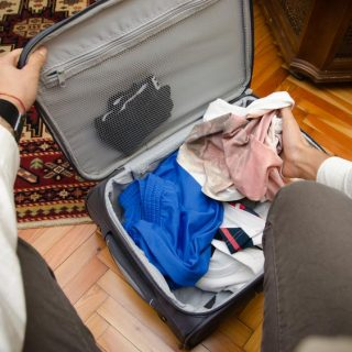 Man packing a suitcase