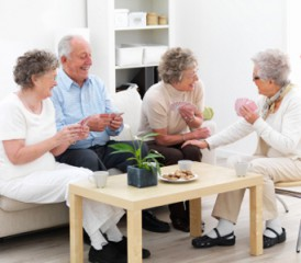 Nursing home residents playing cards