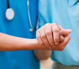 Doctor Holding a Patient's Hand