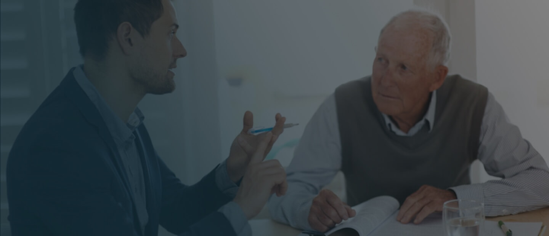 Man advising an older client