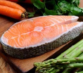 Salmon steak on a wooden board