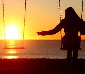 Women on a Swing Enjoying the Sunset